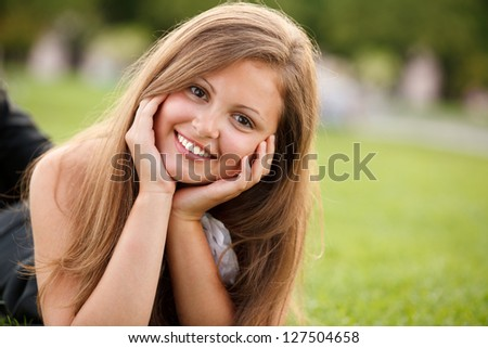 Young pretty girl smiling looking at camera - stock photo