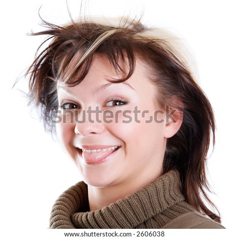 Young pretty girl sticking her tongue out - stock photo