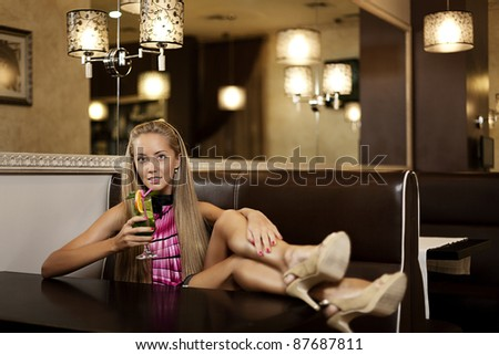 Young pretty girl with cocktail - stock photo