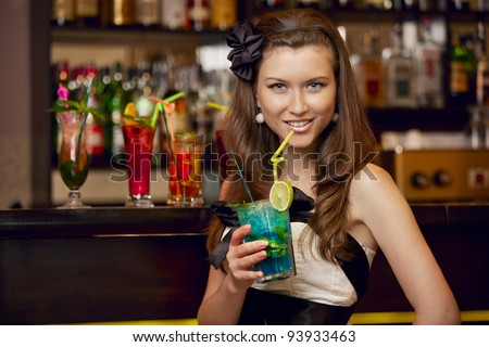 Young pretty girl with cocktail