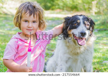young pretty girl with dog outdoor portrait - stock photo