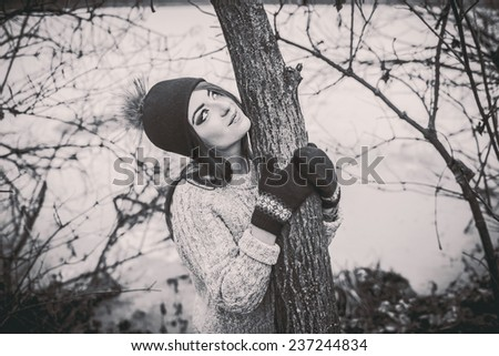 Young pretty girl with forest and lake on background