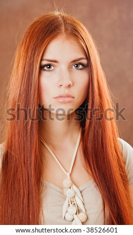 Young pretty girl with red hair portrait