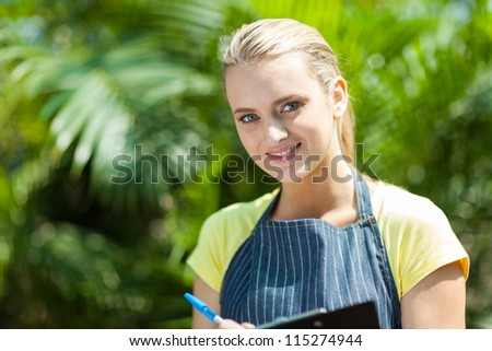 young pretty greenhouse worker portrait - stock photo