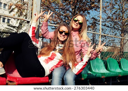 Young pretty hipster girls friends having fun. Lifestyle trendy portrait - stock photo