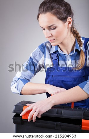 Young pretty independent repairwoman finishing her work
