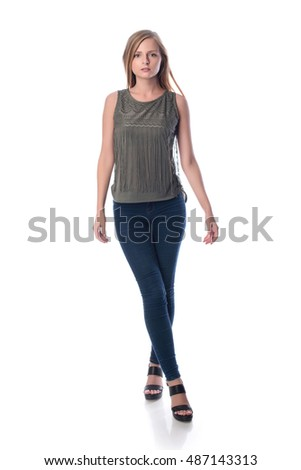 Young pretty long haired blonde woman posing in casual clothes on white background in a studio. Spring summer photo, catalog collection