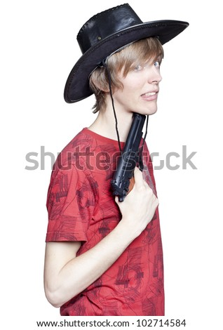 Young pretty man with gun - stock photo