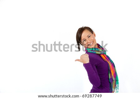 Young pretty model gesturing towards copy space