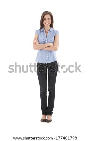 Young pretty office worker girl standing with arms folded, smiling happily, isolated on white, full length. - stock photo