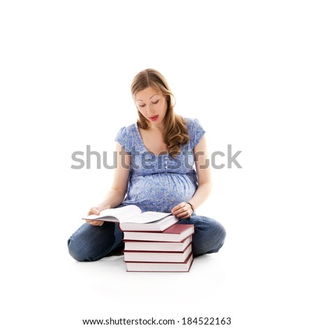 young pretty pregnant woman reading a book