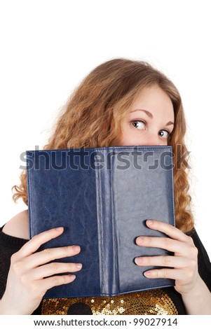 young pretty red haired girl looking out of the note book