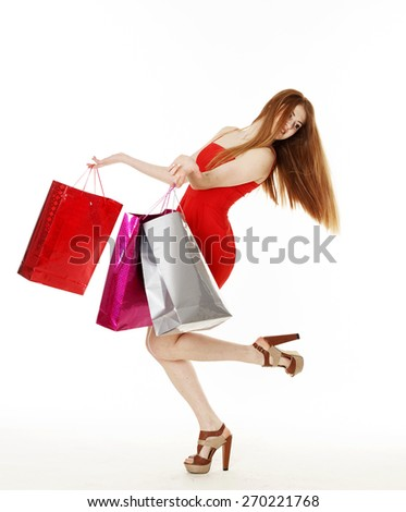 Young pretty redhead woman makes shopping - stock photo