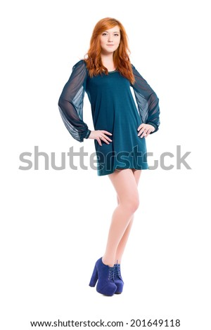 Young pretty redhead woman posing in turquoise dress. Isolated on white - stock photo