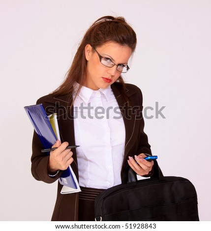 Young pretty secretary with eyeglasses - stock photo