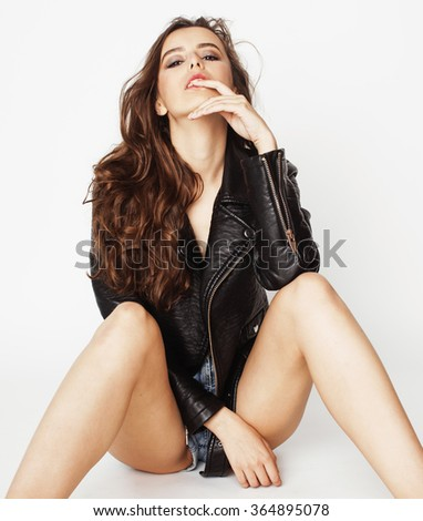 young pretty sexy woman in leather jacket, lifestyle hipster girl posing isolated on white background - stock photo