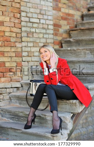Young pretty smiling girl portrait - outdoors  - stock photo