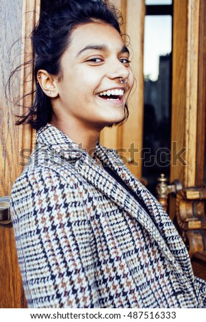 young pretty student teenage indian girl in doors happy smiling, having fun, lifestyle people concept