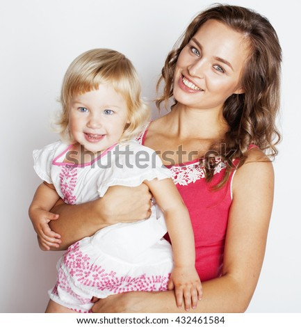 young pretty stylish mother with little cute daughter hugging, happy smiling family, lifestyle people concept - stock photo