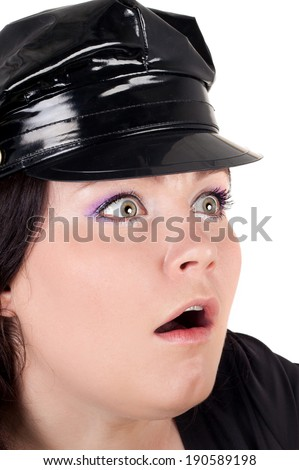 young pretty surprised police woman with the pistol in her hands - stock photo