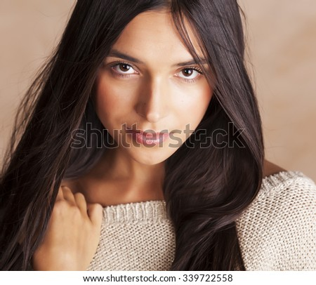 young pretty tanned girl close up portrait smiling confident brunette warm - stock photo