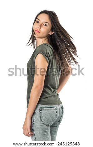 Young pretty teenager girl turning her head and looking back - stock photo
