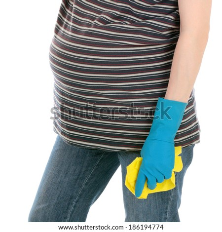 young pretty tired pregnant woman after cleaning the house - stock photo