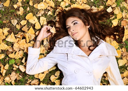 Young pretty woman at the autumn park