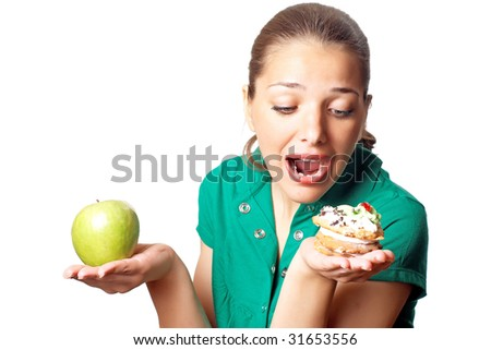Young pretty woman. Dilemma. Apple or cake. Health or tasty.