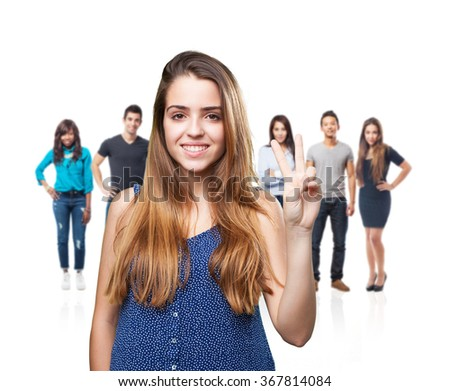 young pretty woman doing number two gesture - stock photo