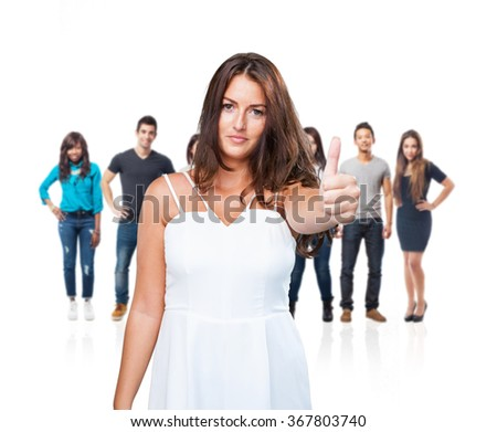 young pretty woman doing okay gesture - stock photo