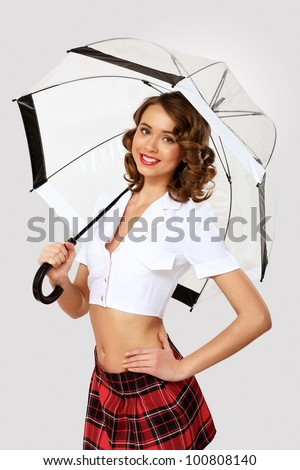 Young pretty woman dressed in retro style with umbrella