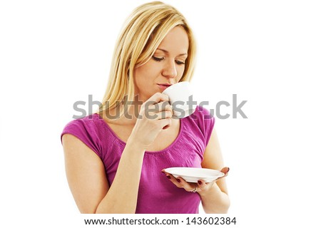Young pretty woman drinking coffee. Isolated on white background. - stock photo