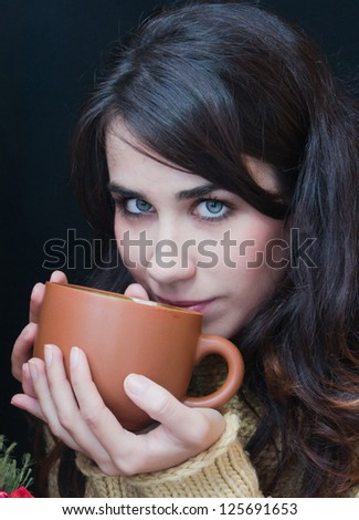 young pretty woman drinking tea