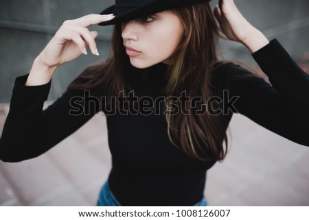 Young pretty woman girl portrait in black hat