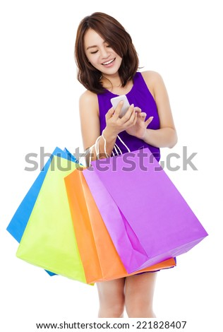 young pretty woman holding a cell phone to shop online over white background