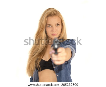 Young pretty woman holding a gun on white background - stock photo
