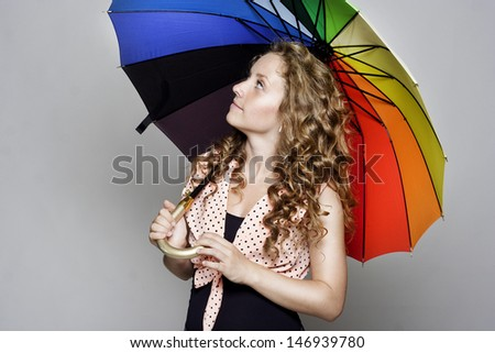 Young pretty woman holding an umbrella