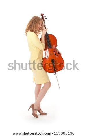 young pretty woman holding cello against white background - stock photo