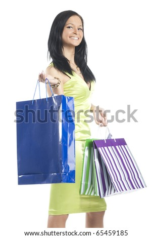 Young pretty woman holding shopping bags