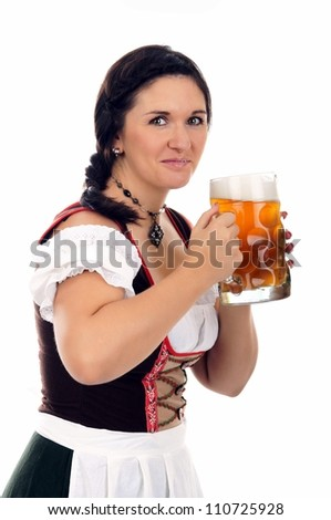 young pretty woman in dirndl with beer mug / munich beer fetival - stock photo