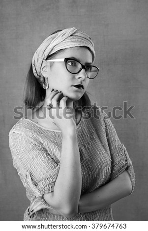 Young pretty woman in glasses black and white portrait