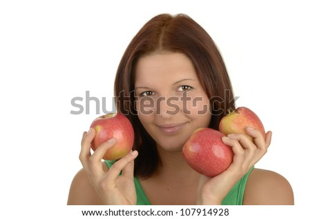 Young pretty woman in green top holding three apples, smiling,  portrait, Isolated