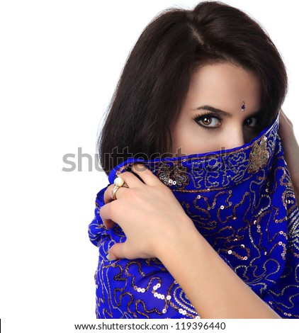 young pretty woman in indian blue dress - stock photo