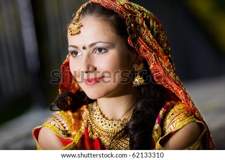 young pretty woman in indian dress look forward - stock photo