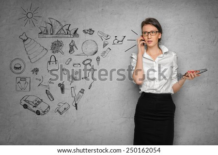 Young pretty woman in office cloth on concrete wall background with business sketches