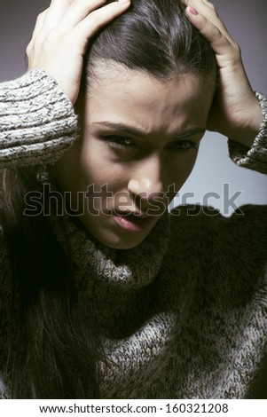 young pretty woman in trouble, screaming in grief - stock photo