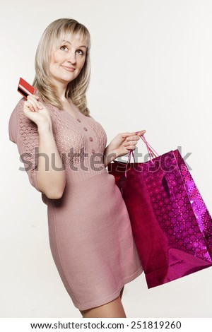 Young pretty woman makes shopping with credit card - stock photo