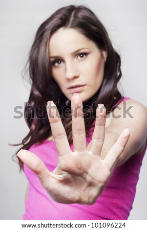 Young pretty woman making stop sign - stock photo