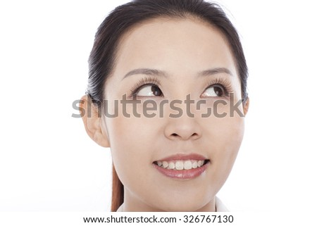 Young pretty woman,portrait,close-up on face - stock photo
